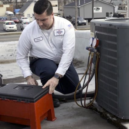 This Reimer AC expert works on this local air conditioner as part of a springtime tune-up.