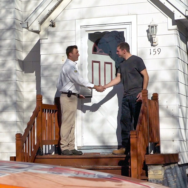 Called in for furnace repairs here in Buffalo, NY, our technician shakes the hand of a local homeowner at the door.