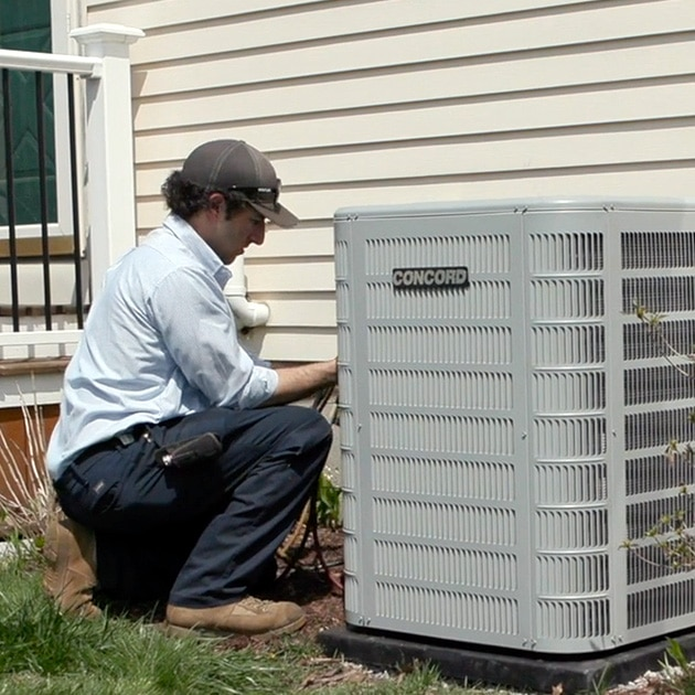 A Reimer HVAC contractor in Buffalo, NY inspects this home's air conditioner, diagnosing any potential issues.